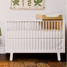 sparrow crib in white and nursery necessities in interior design