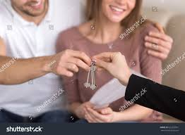 close happy couple getting keys their stock photo 622355591