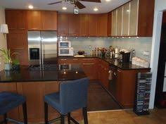 Adel Medium Brown Cabinets With A Eyecatching Backsplash IKEA - Medium brown kitchen cabinets