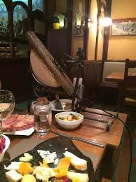 Buffet Heat Lamp by Raclette With Heat Lamp Melting Cheese Over Potatoes