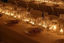 outdoor wedding centerpieces with candles in mason jarswedwebtalks