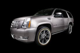 cadillac escalade with vogue white u0026 gold sidewall tyres