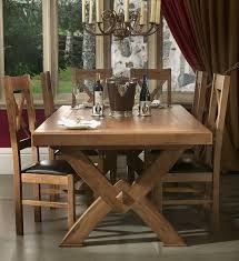 chateau solid oak cross leg extending dining table oak furniture uk