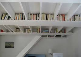 furniture ivory ceiling bookshelf featuring ivory base board as