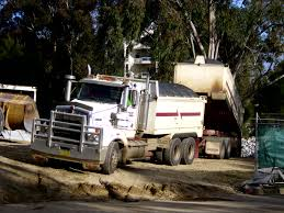 how much does a new kenworth truck cost file tip truck and quad dog trailer jpg wikimedia commons