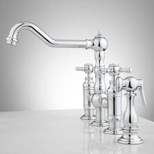 delilah deck mount bridge faucet with side spray cross handles