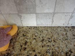how to caulk a sink backsplash caulking kitchen backsplash continue to use the sponge finished