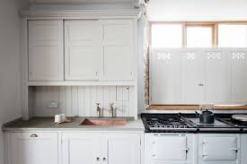 kitchen of the week the plain english power in numbers kitchen pierced wood interior shutters in a dorset farmhouse kitchen by plain english