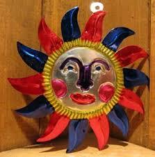mexican tin ornaments sun convivio bookworks