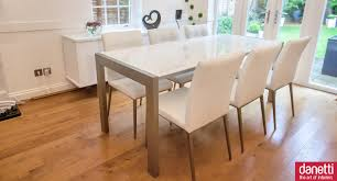 dining room expandable dining table set in white on wooden floor