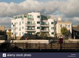 block of art deco style modern waterside flats and apartments