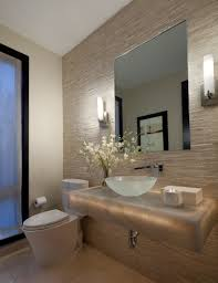 Small Powder Room Ideas by Textured Wall Wall Sconce Flower Arrangement Tiled Floor Glass