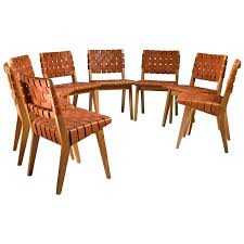 jens risom set of eight webbed knoll chairs with leather webbing