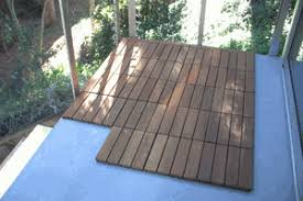 eco arbor designs installation of interlocking deck tiles