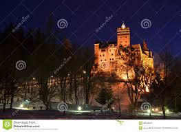 dracula castle with lights at night in romania stock photo image