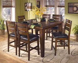Pub Dining Room Set by Signature Design By Ashley Larchmont Butterfly Leaf Pub Table And