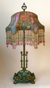 this is a hand painted detailed ornate early 1900s metal lamp