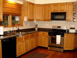 light wood kitchen cabinets with black countertops kitchen cabinet