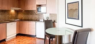one bedroom suite seasons darling harbour 1 bedroom apartment kitchen and meals area