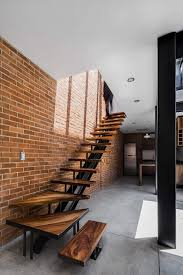 Modern Brick Wall by Exposed Brick Walls Steal The Show In This Modern Industrial Home