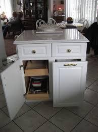 kitchen island with hidden trash bin
