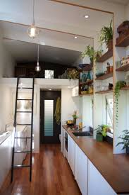 ideas about tiny house company pinterest houses the tiny house company introduces model with retractable bed living shoebox