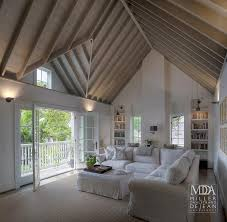 fabulous family room features cathedral ceiling accented with wood