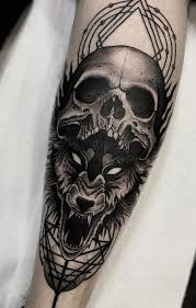 skull and wolf tattoo on leg
