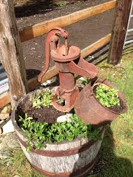 we took an old water pump and 2 half wine barrels to create this
