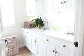 laundry room cabinet knobs white laundry room cabinets with brushed brass octagon knobs white