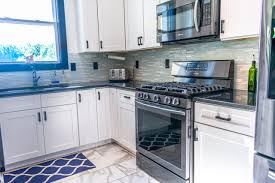 gray kitchen cabinets with black stainless steel appliances absolute black granite