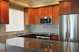 what paint color goes best with cherry wood cabinets the best paint colors for kitchens with cherry cabinets hunker