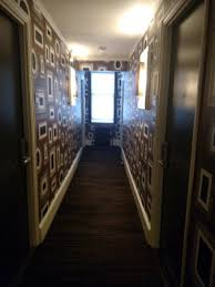 hallway with funky wallpaper picture of empire hotel new york