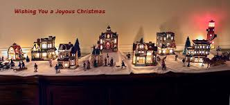 lighted ceramic village greetings photograph by sally weigand