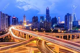 Modern City Shanghai Highway Overpass With Modern City Skyline In Nightfall
