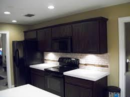 kraftmaid white kitchen cabinets espresso kitchens with white granite backsplash ideas countertops
