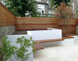 contemporary yard design with artificial lawn raised beds and