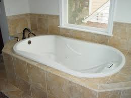 bed bath inspiring bathtub shower combo ideas with bathroom oval white fiberglass combo bathtub with black polished metal faucet surround in light brown ceramic panel