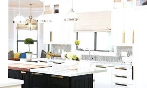 white kitchen cabinets with black hardware modern brass cabinet hardware black and white herringbone mid