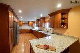 oak kitchen cabinets with oak flooring all wood cinnamon cabinets oak wood floor kitchen