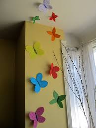 hillary chybinski how to make your own butterfly garden paper butterflies hung on the wall