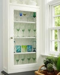 chicken wire cabinet door inserts chicken wire cabinet door inserts use old chippy window too