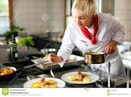 Designing A Restaurant Kitchen Female Chef In A Restaurant Or Hotel Kitchen Cooki Stock Images