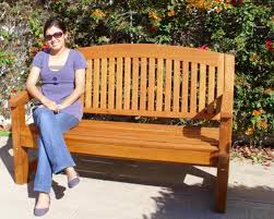 curved wood memorial bench outdoor redwood seating