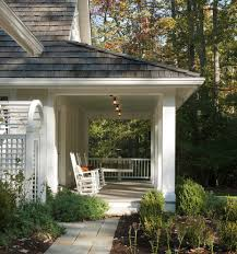 contemporary side porch exterior farmhouse with red door panel