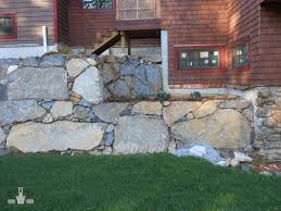 Freestanding Rock Wall Design  Construction Prime Construction - Rock wall design