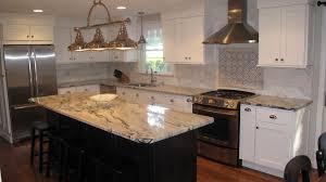 White Kitchen Black Island Love This Silver Cloud Granite With White Cabinets And Black