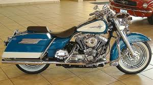 photo of 2001 harley davidson flhr road king motorbike with teal