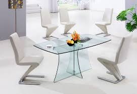 small modern glass dining table with lucite bases and s shaped