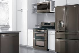gray kitchen cabinets with black stainless steel appliances are stainless steel appliances going out of style